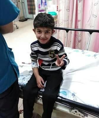 الطفل : أحمد عصام الفرا يعود الى قطاع غزة بعد رحلة علاجية بالضفة المحتلة